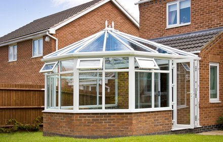 conservatory with white panels and double doors